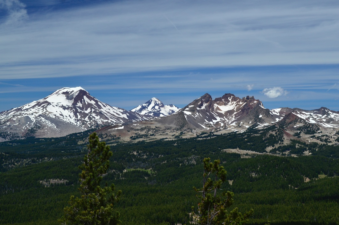 Broken Top and the Three Sisters from Tumalo Mountain