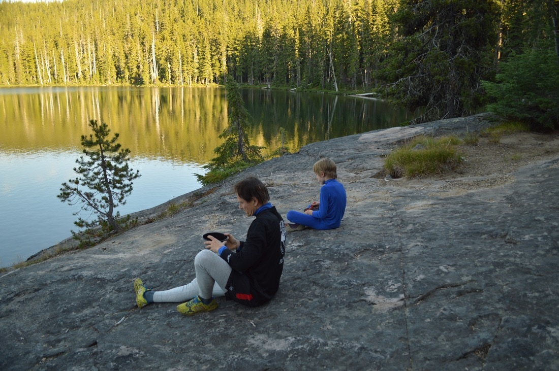 Eating dinner at the edge of Bobby Lake Pacific Crest Trail Oregon
