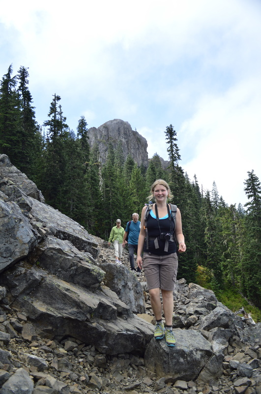 Kali Drugan on the Tidbits Mountain trail with Tidbits Mountain in the background