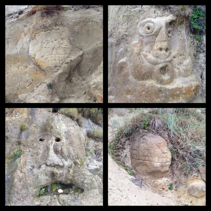 Faces carved into the sand at Hobbit Beach